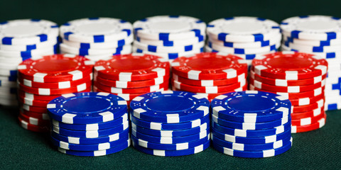 Stacks of poker chips representing a gambling win at a casino or poker or craps game.