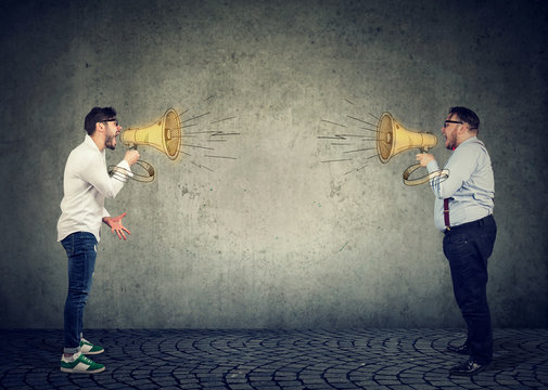Business men screaming into a megaphone at each other