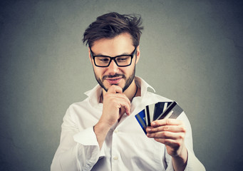 Content man with plenty of credit cards