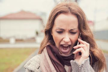 Screaming woman having phone converstation outside