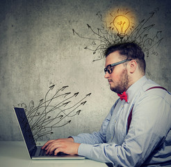 business man working on laptop has bright ideas