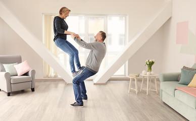 Happy mature couple having fun at home