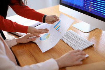 Women working in office. Finance trading