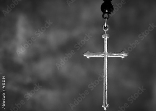 Closeup photo of the silver cross in black and white tone