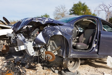 a dark blue car after of a head on collision