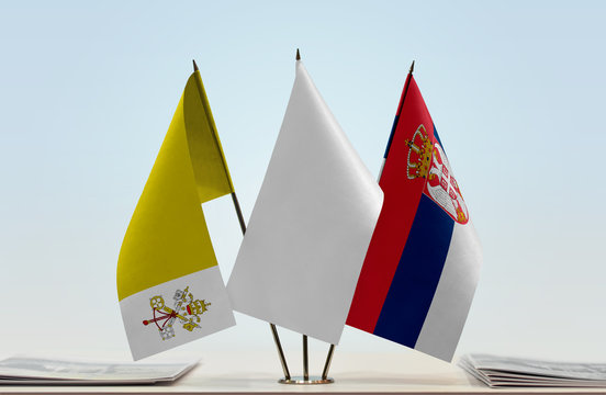 Flags of Vatican City and Serbia with a white flag in the middle