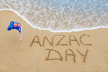 Words Anzac day  on the sand