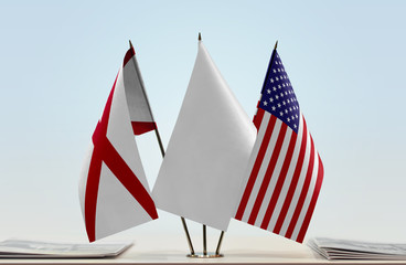 Flags of Alabama and USA with a white flag in the middle