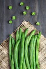 Green beans on wooden  backgroun