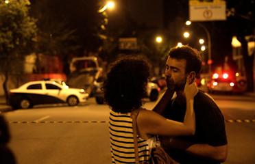 Rio de Janeiro assemblyman Marcelo Freixo (R) reacts at the crime scene where city councilor Marielle Franco was shot dead in Rio de Janeiro