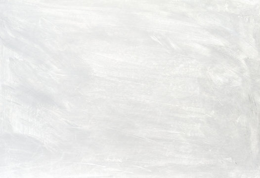 White washed painted textured abstract background with brush strokes in gray and black shades.