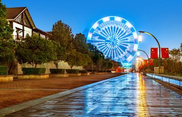 Night, a rotating Ferris wheel.