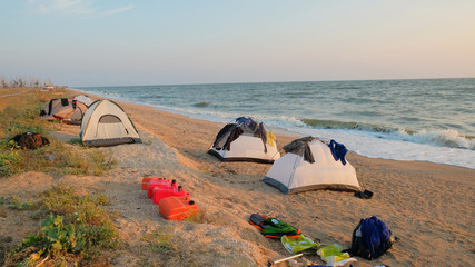 tourist tents on the sandy beach of the sea in the morning clothes dry after shipwreck