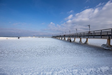 snow covered beach and sea