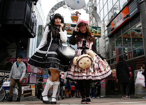 """Ai and Hamuka dressed in """"Lolita fashion"""", influenced by Victorian style, pose for a photographs at  Harajuku shopping district in Tokyo"""