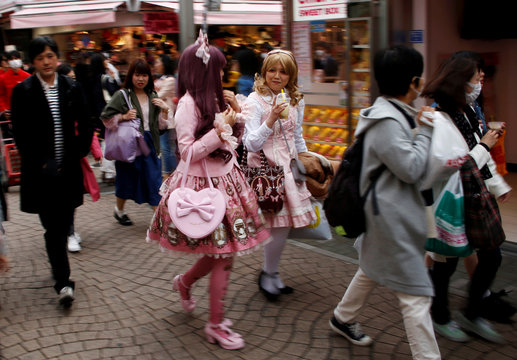 """Sera and Riri dressed in """"Lolita fashion"""" which influenced by Victorian style, make their way at  Harajuku shopping district in Tokyo"""
