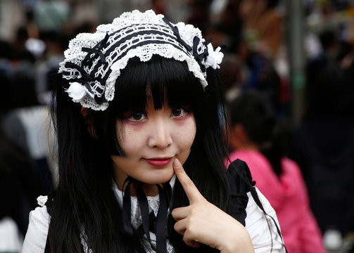 """Hamuka dressed in """"Lolita fashion"""", influenced by Victorian style, poses for photographs at Harajuku shopping district in Tokyo"""