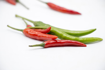Red and Green Chillies are on white background