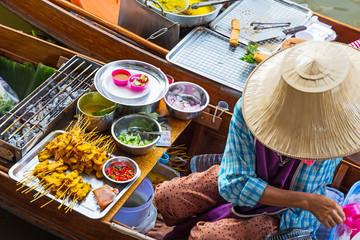 Traditional floating market in Damnoen Saduak in Thailand