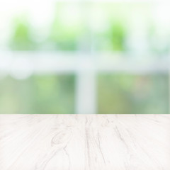 Empty wooden table with blurred green background.