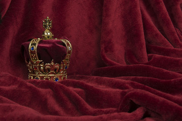 Royal crown on a red velvet background