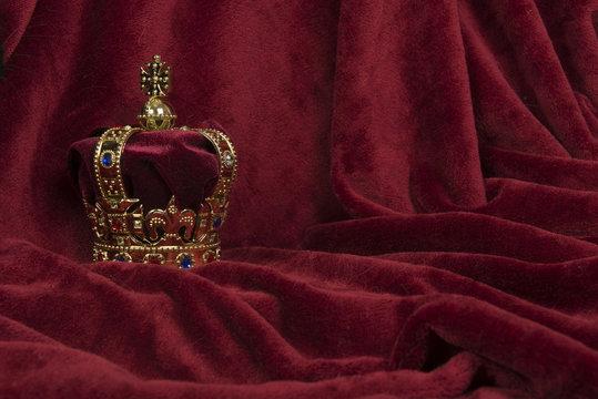 Royal crown on a red velvet background