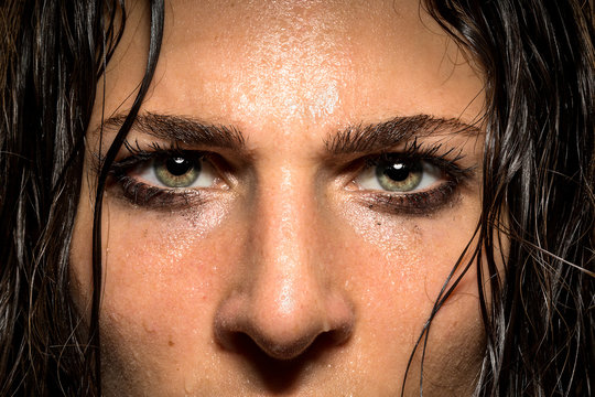 Expression in female athlete eyes showing focus, determination, conviction, power, courage