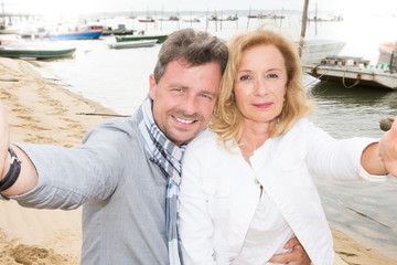 mature couple selfie on port beach vacation