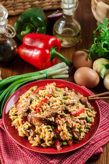 Fried rice with chicken and vegetables served on a plate