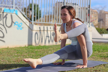Woman doing yoga and fitness in the park