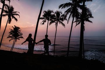 Silhouettes of beautiful couple on sunset. Sri Lanka