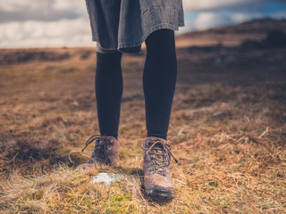 Legs and feet of woman walking on moor