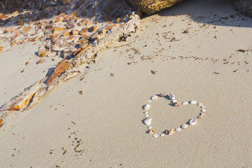 Heart shaped from shells lies on a beach in the sand on Koh Samui