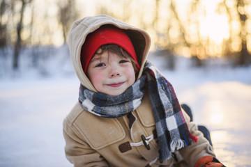 Portrait of a smiling boy sitting on frozen lake