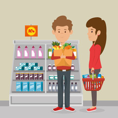 consumers with supermarket basket of groceries