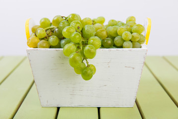Grapes on the table. A bunch of ripe grapes in a basket. Picnic. Natural vitamins. Healthy eating.
