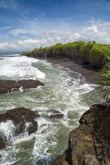 Rocky beach coastline near Tanah Lot, Beraban, Bali, Indonesia
