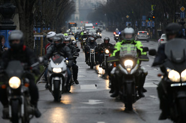 People ride motorcycles to attend the Hungarian march at a pro-Orban rally during Hungary's National Day celebrations in Budapest