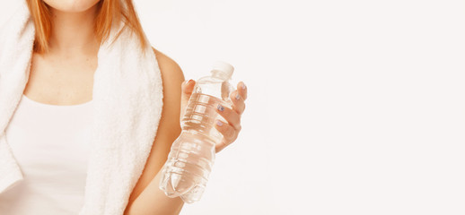 Beautiful woman  bottle of natural water. (food, healthy lifestyle, vitamins concept)