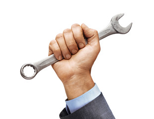Man's hand in a suit holds a wrench isolated on white background. Close up. High resolution product