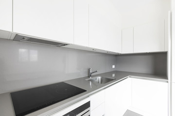 Detail of modern white kitchen, corner detail, clean space