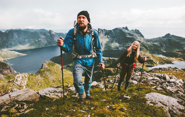 Couple travelers hiking in mountains family traveling together adventure lifestyle concept vacations outdoor Wall mural