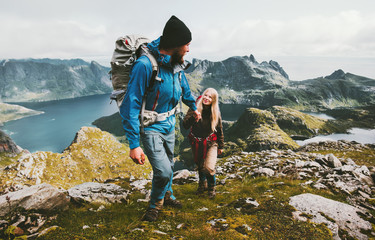 Couple backpackers hiking in Norway mountains love and travel holding hands family together Lifestyle concept vacations outdoor Wall mural