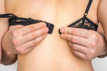 Man undresses bra off his girlfriend