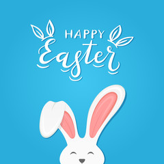 Blue background with text Happy Easter and rabbit ears