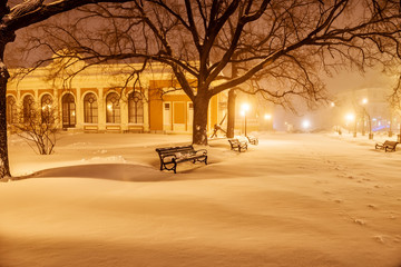 Fotobehang - Night photo of city streets, city park covered with snow. Ukraine. Odessa.
