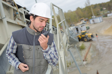 worker using radio on construction site