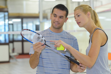 couple with badminton rackets in hands