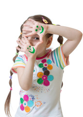 cheerful child girl showing her hands painted in bright colors.