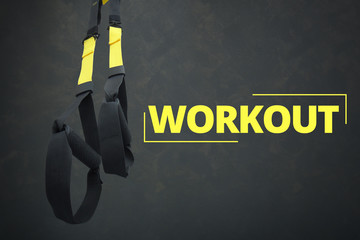 Straps training loop equipment. Black loop functional training equipment on grey background. Sport accessories. Fitness and Gym workout items for Healthy.